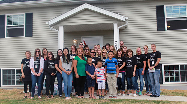 Integrity and Vang Family at the Habitat for Humanity home dedication